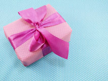 Gift box with blue polka dot background with space copy Royalty Free Stock Photos