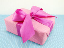 Gift box with blue polka dot background with space copy Royalty Free Stock Photography