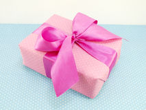 Gift box with blue polka dot background with space copy Stock Image
