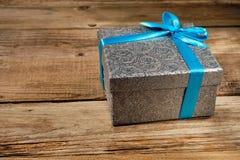 Gift box with blue ribbon Royalty Free Stock Photos
