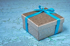 Gift box with blue ribbon Royalty Free Stock Images