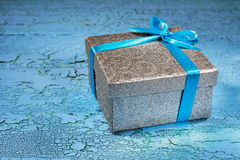 Gift box with blue ribbon Stock Image