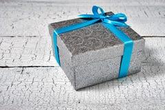 Gift box with blue ribbon Royalty Free Stock Photo