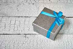 Gift box with blue ribbon Royalty Free Stock Image