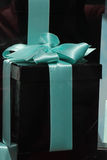 Gift box with blue ribbon Stock Images