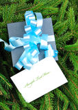 Gift box with blue ribbon and Christmas card Stock Photo