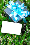 Gift box with blue ribbon and Christmas card Stock Images