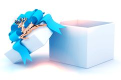 Gift box with blue ribbon and a Golden deer. Stock Photo