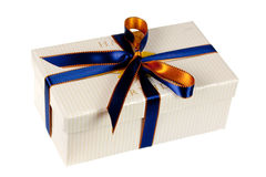 A gift box,with blue ribbon,isolated on white Stock Photo