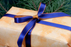 Gift box,with  blue ribbon, on  textile ba Royalty Free Stock Photos