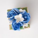 Gift box with blue rose on gray background Royalty Free Stock Photos