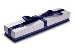 Gift box with blue satin ribbon bow Stock Image