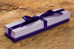 Gift box with blue satin ribbon bow, Royalty Free Stock Photography