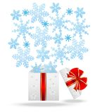 Gift box with blue snowflakes Royalty Free Stock Photos