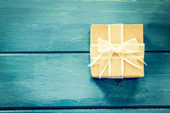 Gift box on blue wooden table Royalty Free Stock Image