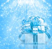 Gift box in blue wrapping paper Stock Image