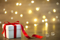 Gift box on boke background. red ribbon. heart. Red gifts tied with a white satin ribbon bow Royalty Free Stock Photo