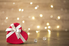 Gift box on boke background. red ribbon. heart. Red gifts tied with a white satin ribbon bow Stock Image