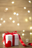 Gift box on boke background. red ribbon. heart. Red gifts tied with a white satin ribbon bow Stock Photos