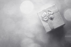 Gift box with bokeh background. Closeup. Stock Photos