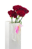 Gift Box and Bouquet from Carnations Flowers Isolated on White. Stock Photo