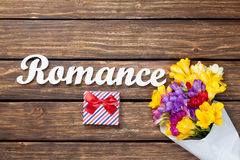 Gift box and bouquet of flowers with word Romance Stock Photography