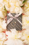 Gift box and a bouquet of peonies Royalty Free Stock Image