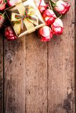 Gift box and bouquet of roses Stock Photography