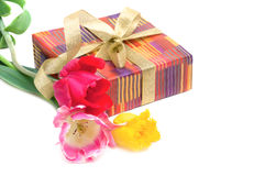 Gift box and a bouquet of tulips Stock Images