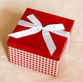Gift box with a bow Stock Images