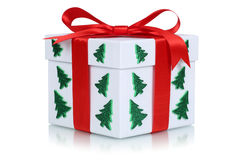 Gift box with bow and Christmas tree royalty free stock photos