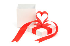 Gift box, bow and heart Royalty Free Stock Photos