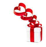 Gift box, bow and heart on a white background Royalty Free Stock Photography