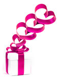 Gift box, bow and heart on a white background Royalty Free Stock Image