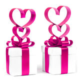 Gift box, bow and heart on a white background Stock Photos