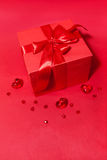 Gift box with bow and hearts on the red background Royalty Free Stock Image