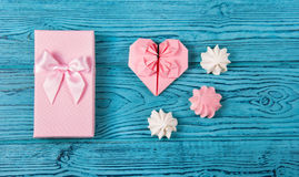 Gift box with bow and paper heart of origami. Romantic gift Stock Images