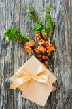Gift box with bow ribbon, blank tag and delicate flowering branch stock image