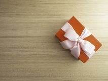 Gift box with bow on wooden background royalty free stock photo