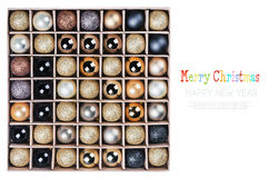 Gift box with bright Christmas balls isolated Royalty Free Stock Images