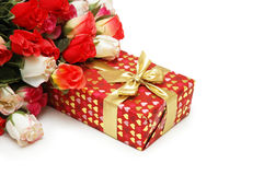 Gift box and bunch of flowers Royalty Free Stock Images