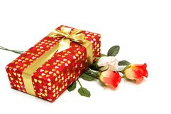 Gift box and bunch of flowers stock images
