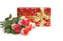 Gift box and bunch of flowers  Stock Photography