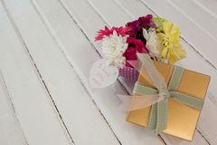 Gift box and bunch of fresh flowers with I love you mom card Stock Photography