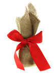 Gift box burlap canvas red bow Stock Image