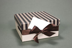 Gift box with a business card. Business card with a text space Stock Images