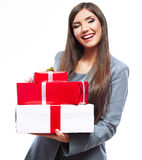 Gift box business woman hold against gray background. Close up Isolated portrait of young smiling model Royalty Free Stock Photo