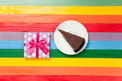Gift box and cake Royalty Free Stock Photography