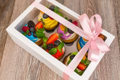 Gift box with cakes of different colors Stock Photo