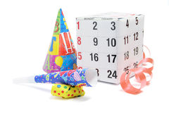 Gift Box with Calendar Page and Party Favors Stock Photo